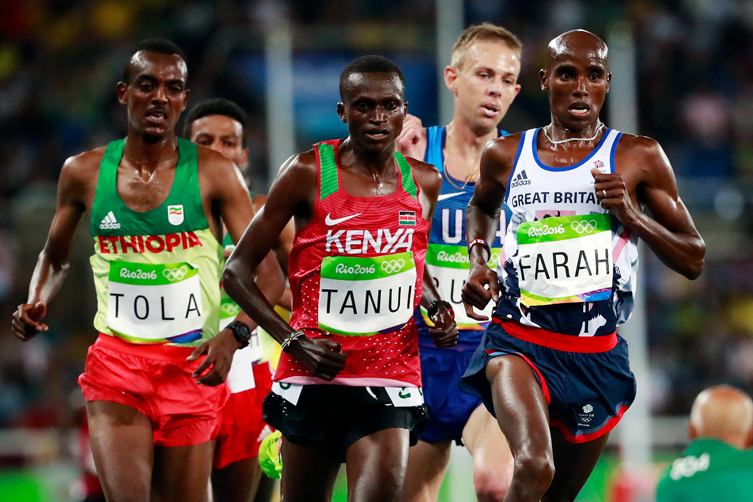 Britain's Mo Farah, right, leads the 10,000m field in Rio